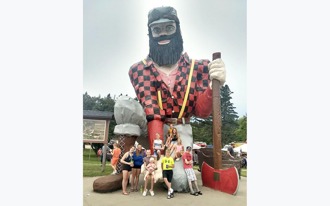During Paul Bunyan Days in Akeley, groups of families and friends gather to snap a photo with the American folklore hero. Photo by Forum News Service