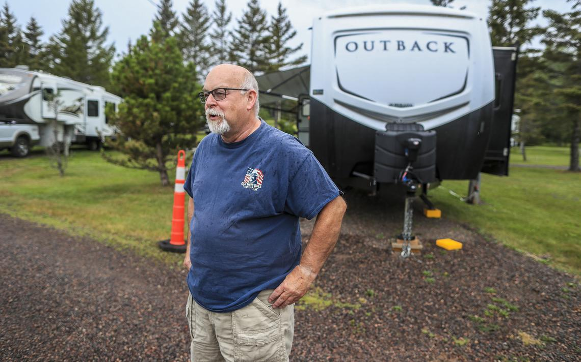 Dennis Saxton, of North St. Paul, talks about camping in his RV at Penmarallter Campground near Two Harbors. (Clint Austin / caustin@duluthnews.com)