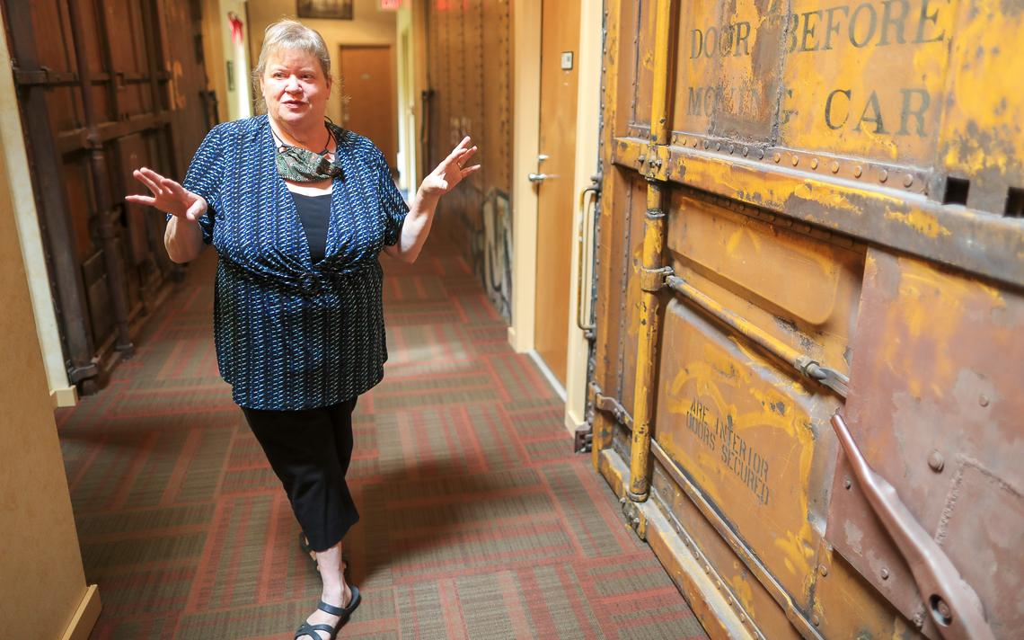 Cyndi Ryder, co-owner of Northern Rail Traincar Inn near Two Harbors, describes the layout of the rooms at the inn. (Clint Austin / caustin@duluthnews.com)