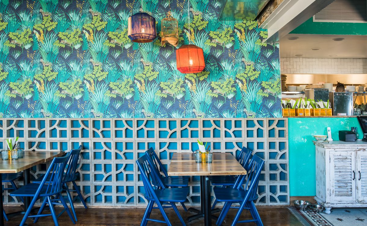 The brightly colored, wallpapered dining room at Hai Hai