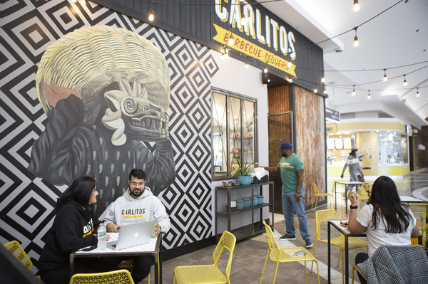 Castillo (left) visits her husband, Carlos, who owns Carlitos Barbecue Taqueria in Paramus, N.J. She tries to visit him about three times a week, sometimes with the kids and sometimes without them.