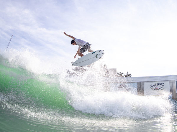Texas surfer Jacob Williams catches big air in Waco, Texas, where artificial waves are generated by compressed air and a computer.
